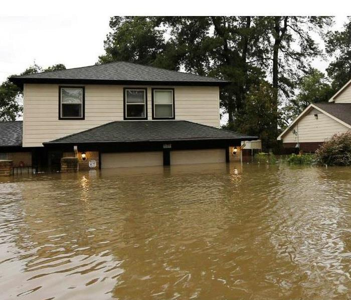 Flood waters outside of a home